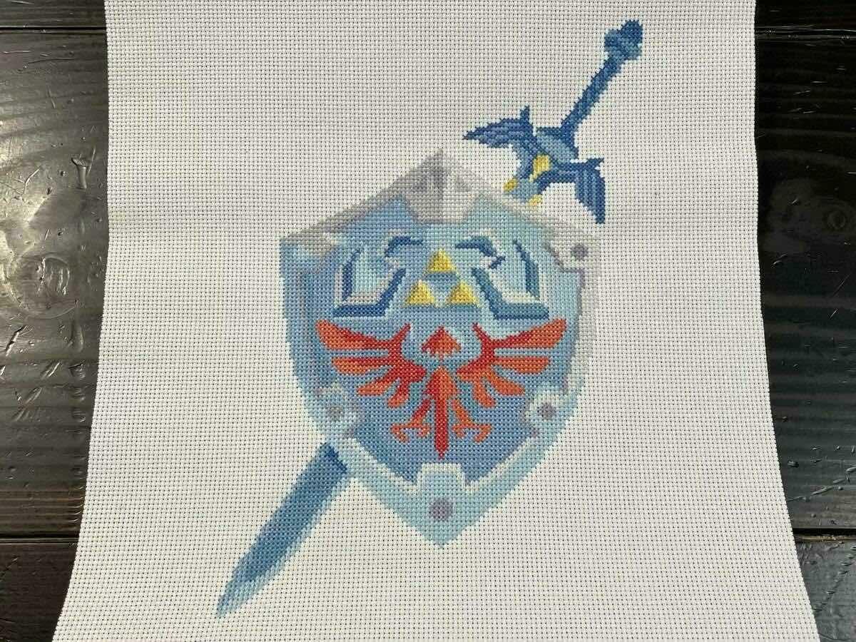 Hylian shield and master sword cross-stitch